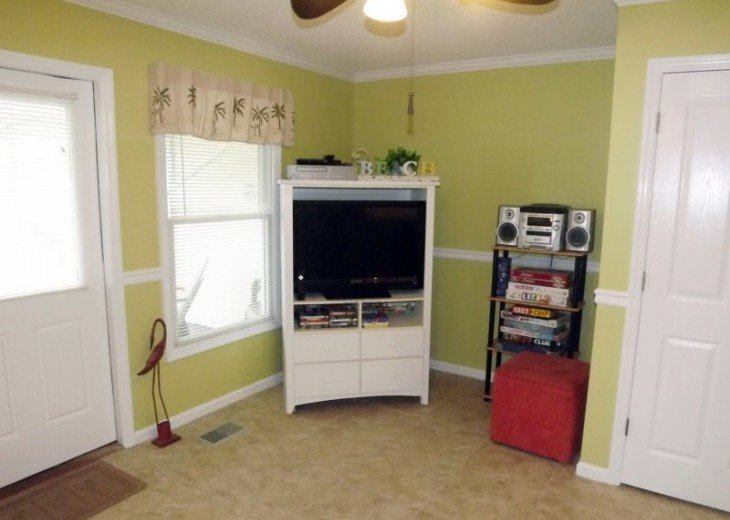 Living area entertainment: HDTV, family-friendly video library, puzzles & games
