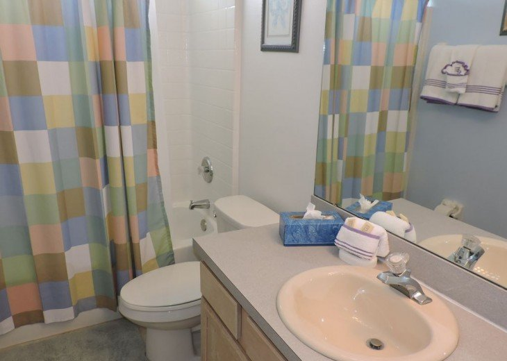 One of 3 bathrooms, this one with both bath and shower