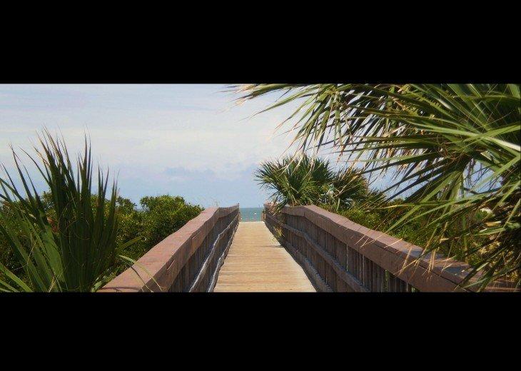 Boardwalk from pool to Beach