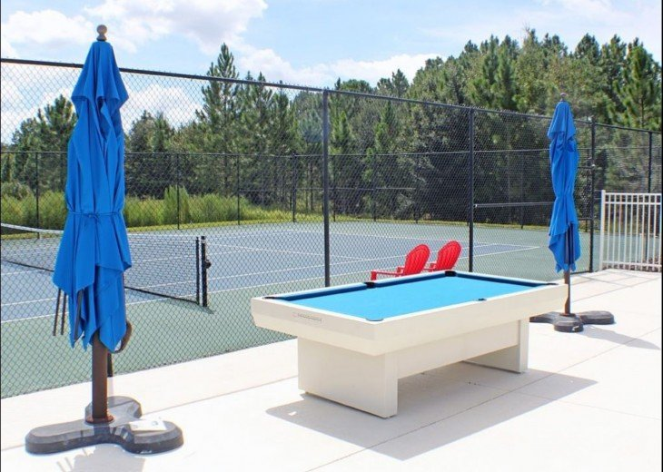 Pool table and table tennis table on the pool deck of Club House