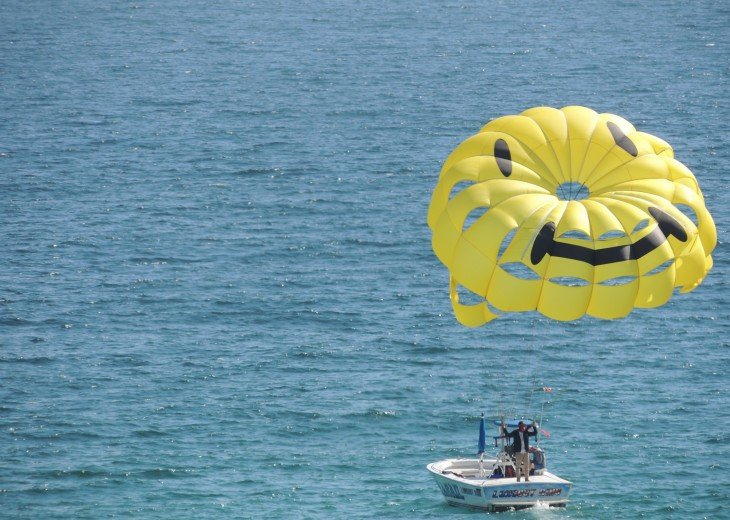One of the many fun water sports onsite~ parasailing with a smile.