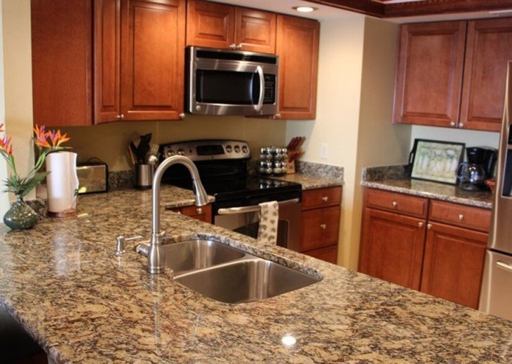 Remodeled kitchen granite counters & quality stainless steel finish appliances.