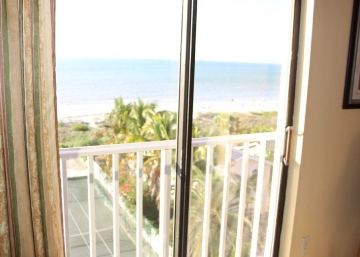 Dedicated view from Master Bedroom over tennis, palm tress and the Gulf!