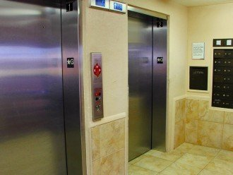 Two elevators service Reef Club shown in the main lobby.