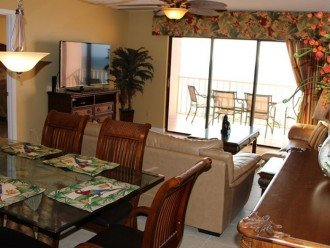 From center dining room to sliding door & balcony to pool, beaches and the Gulf!