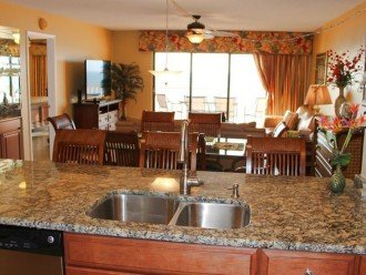 Granite and view over dining, living, wet bar & toward balcony, beaches & Gulf.