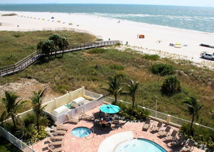 Hot Tub, Kiddie Pool, Lounge Chairs and of course the gorgeous big beach view.