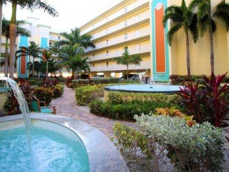 Courtyard During the Day - Center Looking Over Fountain Toward Tiki Bar & Beach.