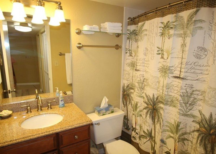 Second bathroom with granite counter and beach appointments.