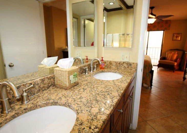 Granite double sink master bath counters serving master br with tile luxury.