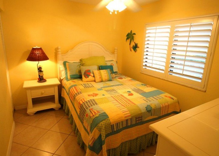Third bedroom with beach appointed furniture and queen bed.