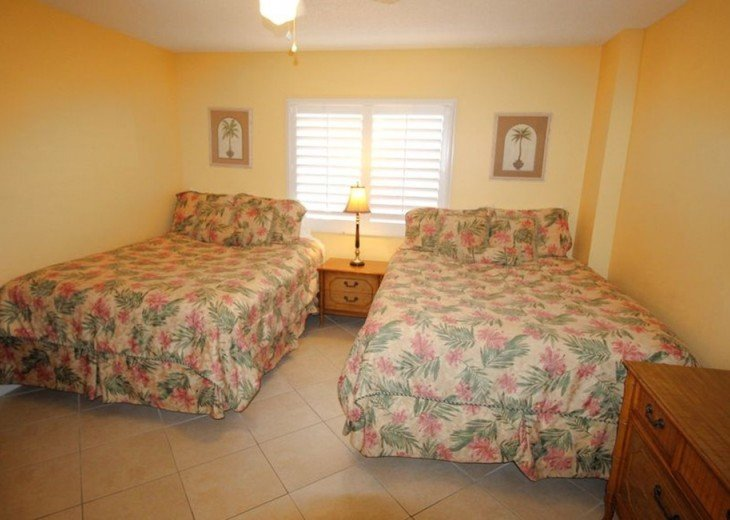 Two queens in second bedroom with TV and DVD - not in picture (at right).