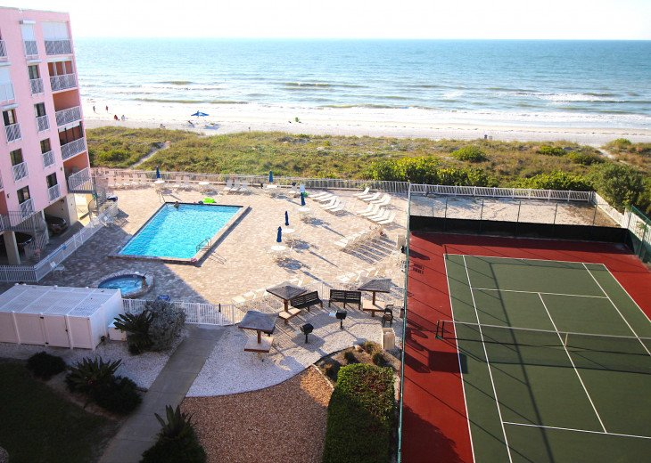 Penthouse Unit view over deck, pool, tennis, grills, hot tub & beautiful beach.