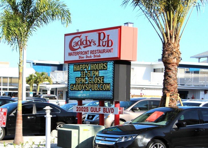 Caddy's Pub Waterfront great Happy Hours - burgers! - and one mile south.