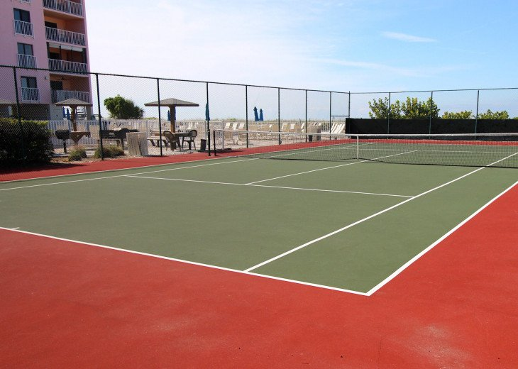 """Newly re-surfaced tennis court """"right there"""" and the best view from our balcony."""