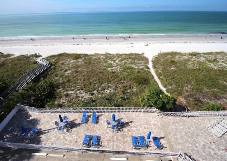 """View from 5th landing overlooking dedicated """"adult area lounge"""" - beach & ocean."""