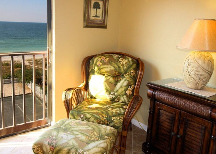 Your own wicker chair and ottoman - on the top floor looking over all of it!