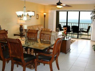 Dining and living room with view toward the balcony & direct topfloor Gulf View.