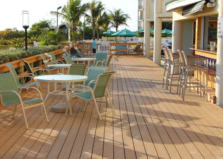 Open deck in front of the resort Tiki bar at right toward main pool & hot tub.