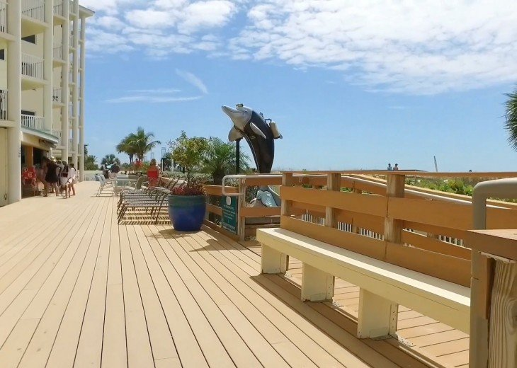 Beautiful open deck in front of the resort by Tiki bar toward kiddie pool.