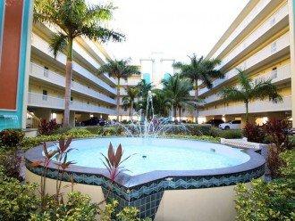 Courtyard During the Day - Center Looking Over Fountain Toward Tiki Bar & Beach.