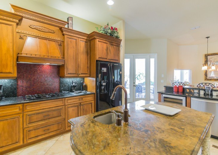 Large kitchen with granite countertops. Walk in pantry