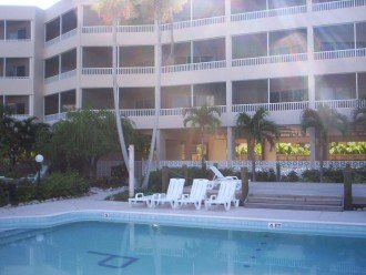 View of condo from side of pool