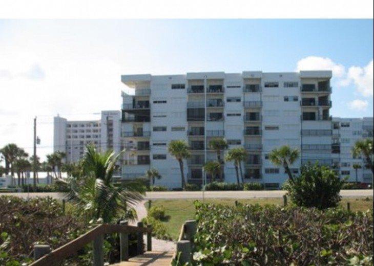 View of oceanside of building from beach walkway
