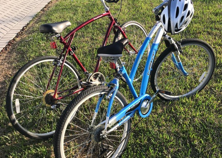 His & Hers bikes, helmets + locks for your ride to the Square & pool.