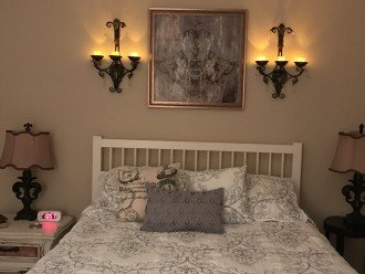 Guest BR - Queen bed and room with a French theme.
