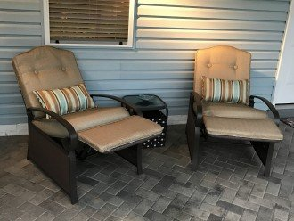 Covered patio with outdoor recliners. (Total seating for 4))