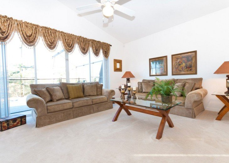 Spacious sitting room with comfortable sofas.