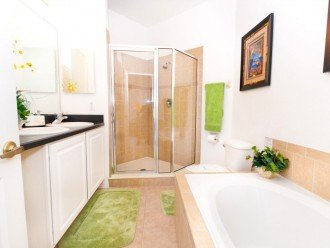Another bathroom with bath and walk in shower