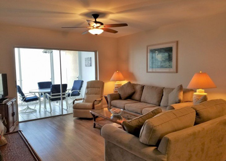 Living room with queen-size sofa sleeper, HDTV, DVD, Stereo and direct Gulf view