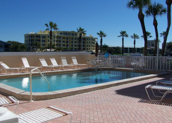Heated pool and clubhouse by the bay