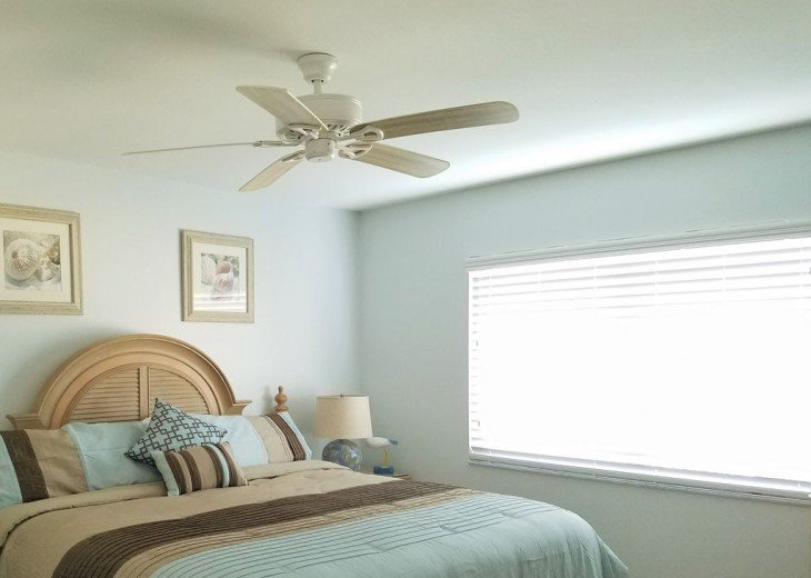 Large master suite with 4 x 6 foot sliding window over beach and Gulf