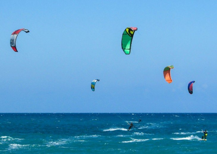 Some days it's windy and you can watch kite-surfers jump 20 feet in the air