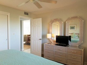 Guest bedroom with HDTV & DVD, abundant dresser storage and large closet