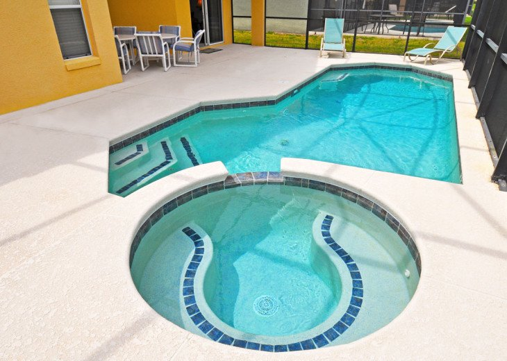 Enjoy your Orlando vacation in a affordable 4 br vacation home with pool & spa #14