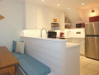 A very large breakfast nook conveniently nestled next to the kitchen