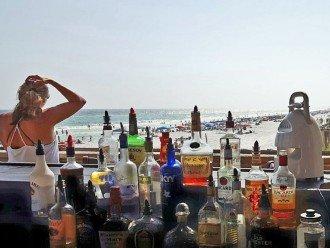 Beach Bar Under Sky Bridge - TV's - Seating - Watch Amazing Destin Sunsets