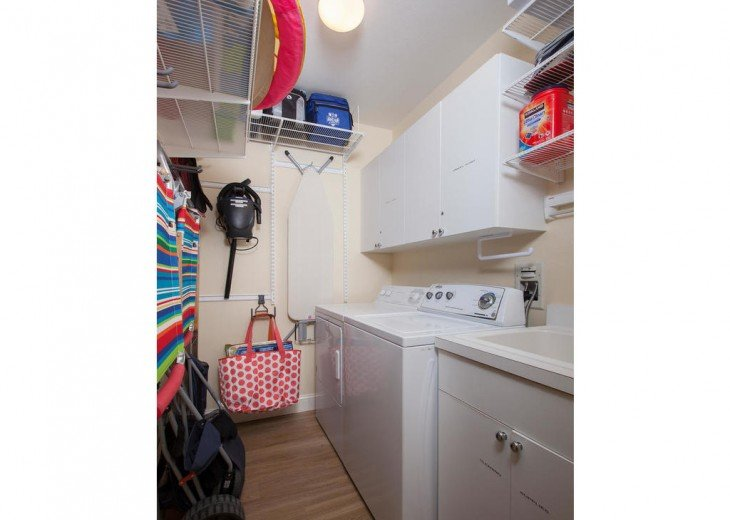 Laundry room offers every necessity for a comfortable stay.