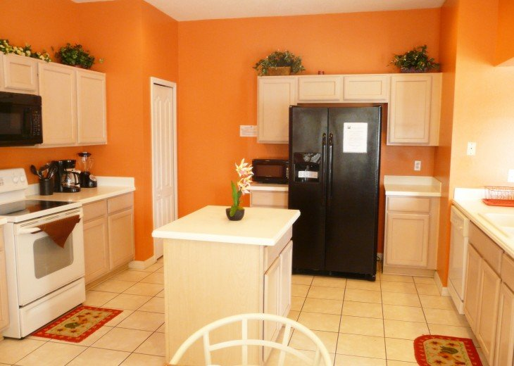 Spacious Kitchen with counter island, huge Refrigerator with ice maker