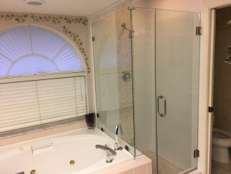 Master bath with garden tub and seamless shower