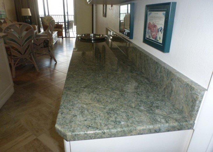 Kitchen with beautiful Costa Esmeralda granite.