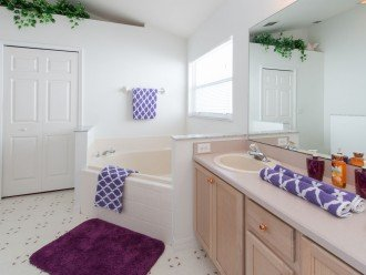 Master Suite 1 - En-suite Bathroom featuring double vanity, large bath tub and w