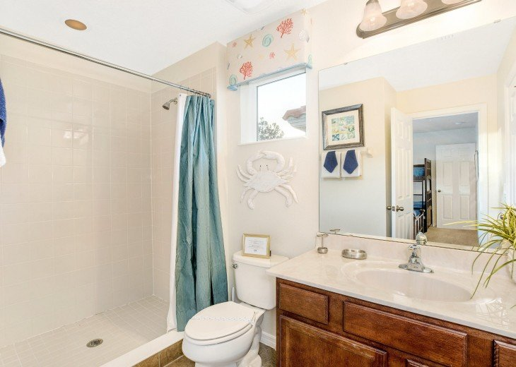 Jack & Jill Bathroom for Bedrooms 5 and 6 - bath with shower over