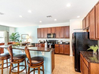 Large well equipped kitchen with breakfast bar