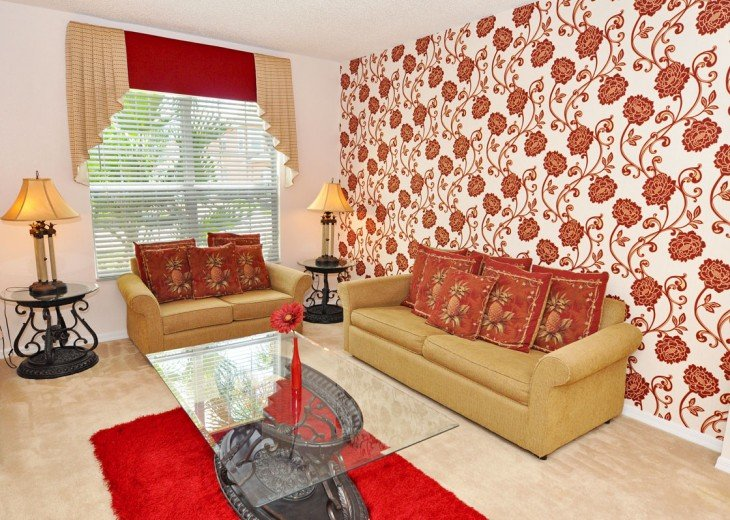Formal lounge at the front of the home with comfy sofas