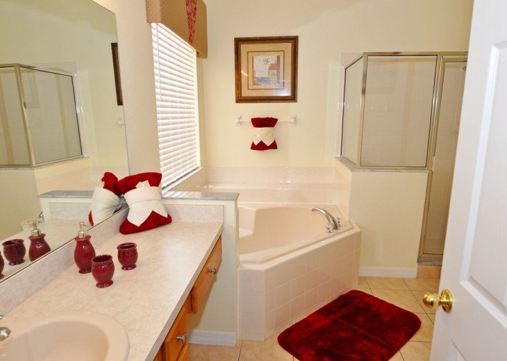 Master Suite 1 - bathroom with corner bath and walk in shower